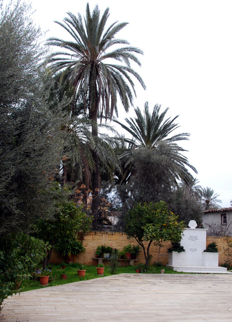 Agios Giorgios church yard with palms and clementine tree