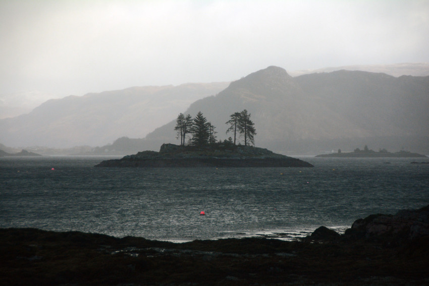 The rain and wind draining colour from the day: one of the many islands scattered in the narrows of Loch Carron from Plockton/Am Ploc
