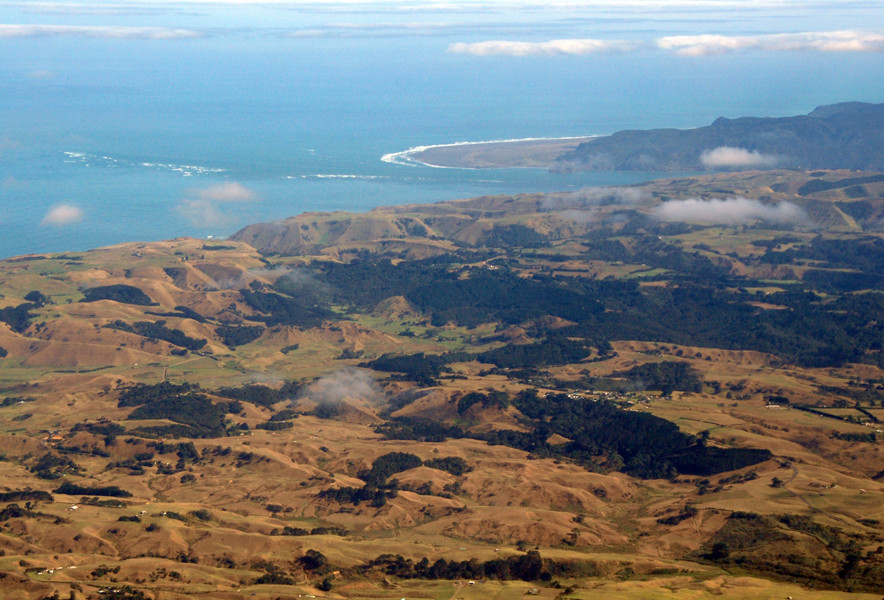 The Manukau Entrance and Whatipu from the air with the extensive sandhills of the coast south of Manukau in the foreground.