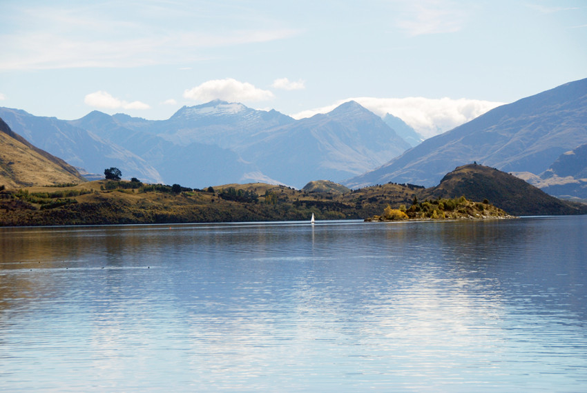 Lake Wanaka, Ruby Island and Mt Aspiring (3027m) from the waterfront at Wanaka.