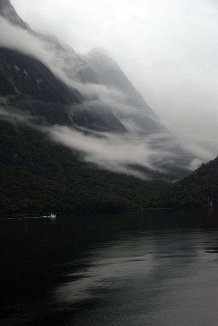 A fishing boat from the Deepwater Basin heading up Milford Sound past the entrance to Sinbad Gully.