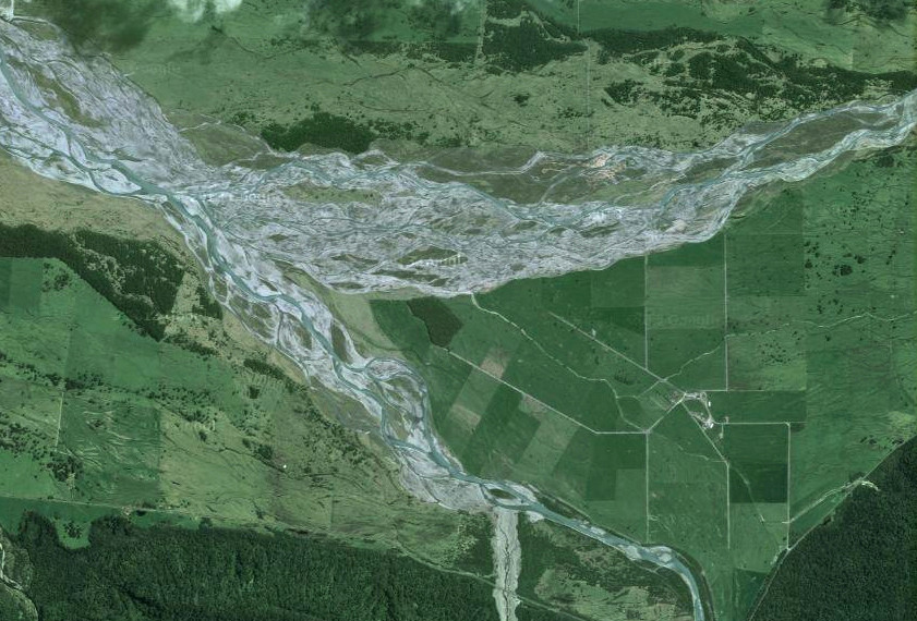 The confluence of the Fox (top) and Balfour (bottom) braided rivers on the coastal plain below the glacial valley showing previous riverbed courses  (NZ Top/Google)