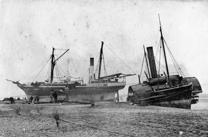 "The steam ship ""William Misken"" and the paddlesteamer tug "" Lioness"", ashore  (aground) at Hokitika. Ref: 1/2-054149-F. Alexander Turnbull Library, Wellington, New Zealand."
