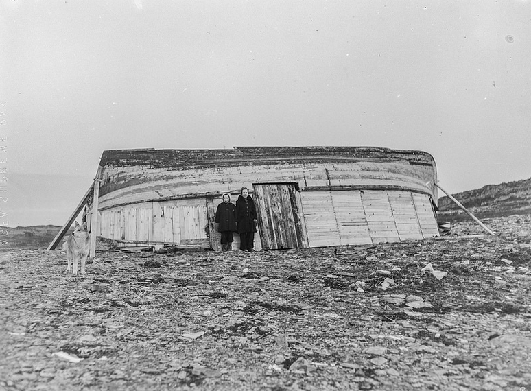 House for 8 people, two cows and a goat built from upturned wooden boat after the devastation of Gamvik in the Nazi's scorched earth policy in Finnmark, Norway (Norway National Archive Arkivreferanse: NTBs krigsarkiv i Riksarkivet (RA/PA-1209/U/Uj/L0214).