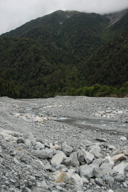 The rubble washed out by Kelly's Creek: 'a braided stony greywacke riverbed'