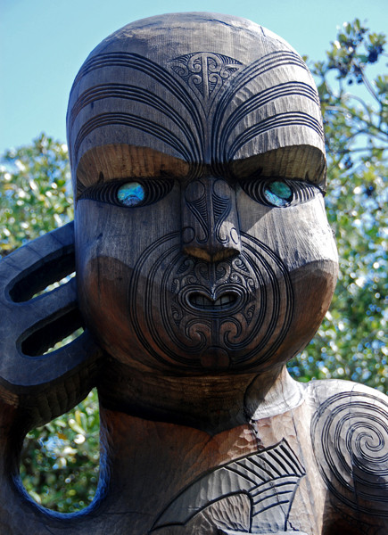 Detail of Maori tradtional carving at Karekare Beach, Auckland.