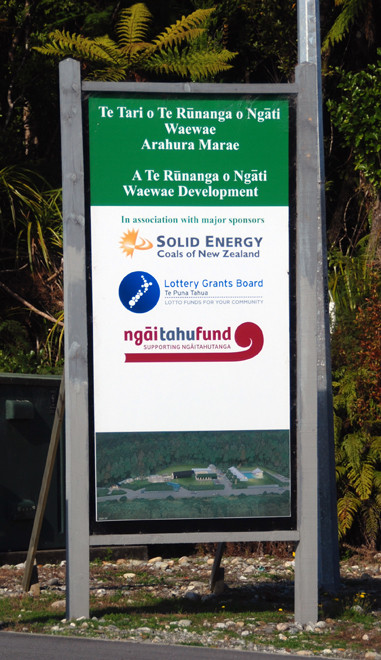 Sponsor's sign outside the Arahura Marae including the Ngai Tahu tribal council and fund, the New Zealand lottery and the state-owned Solid Energy.