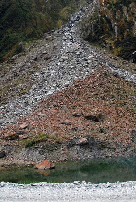 Scree and lake made by underground ice melting after the Fox Glacier's retreat from its highpoint in the 1890s.