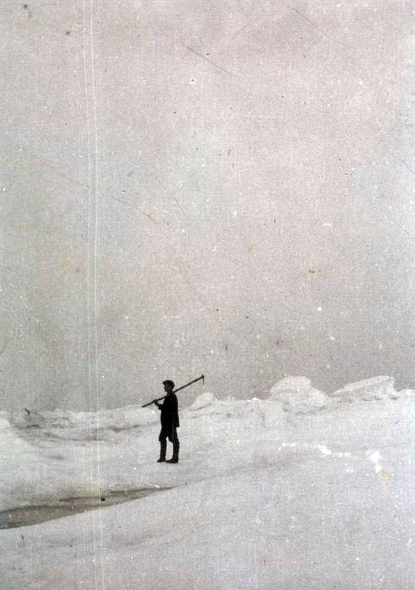 Crew member of the sealer, Correct, on pack ice with a hakapik in 1913 (Wikimedia Commons)