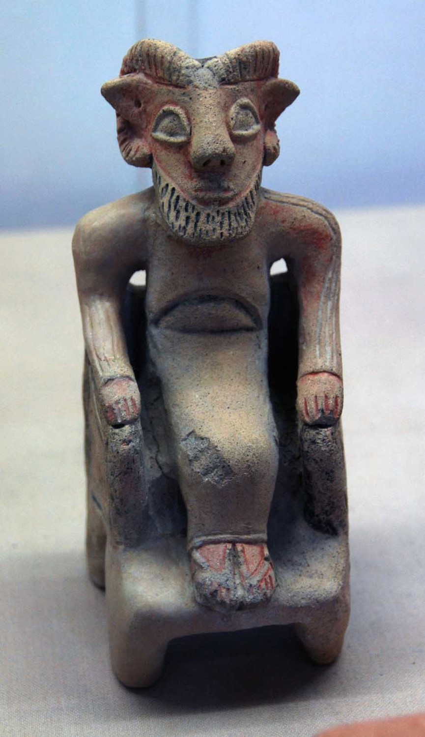 Seated horned figure from Meniko Sanctuary showing Phoenicean influences, 6th Century BC: Cyprus Museum