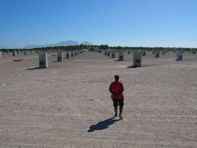 Serviced plots for tented accomodation (?) in the Blikkiesdorp Temporary Relocation Area at Delft 34km north-east of Cape Town with Table Mountain in background (coutesy Kerry Chance)