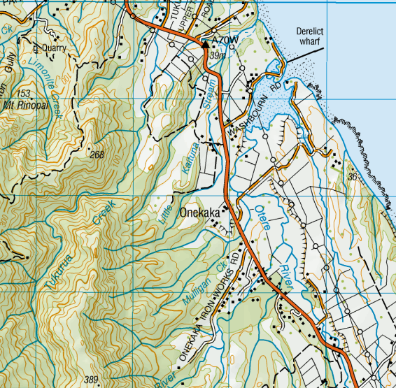 Map showing the derelict Onekaka Iron Works wharf, Iron Works Road and (top right) Limonite Creek - the original source of the iron ore (NZ Topo Map).