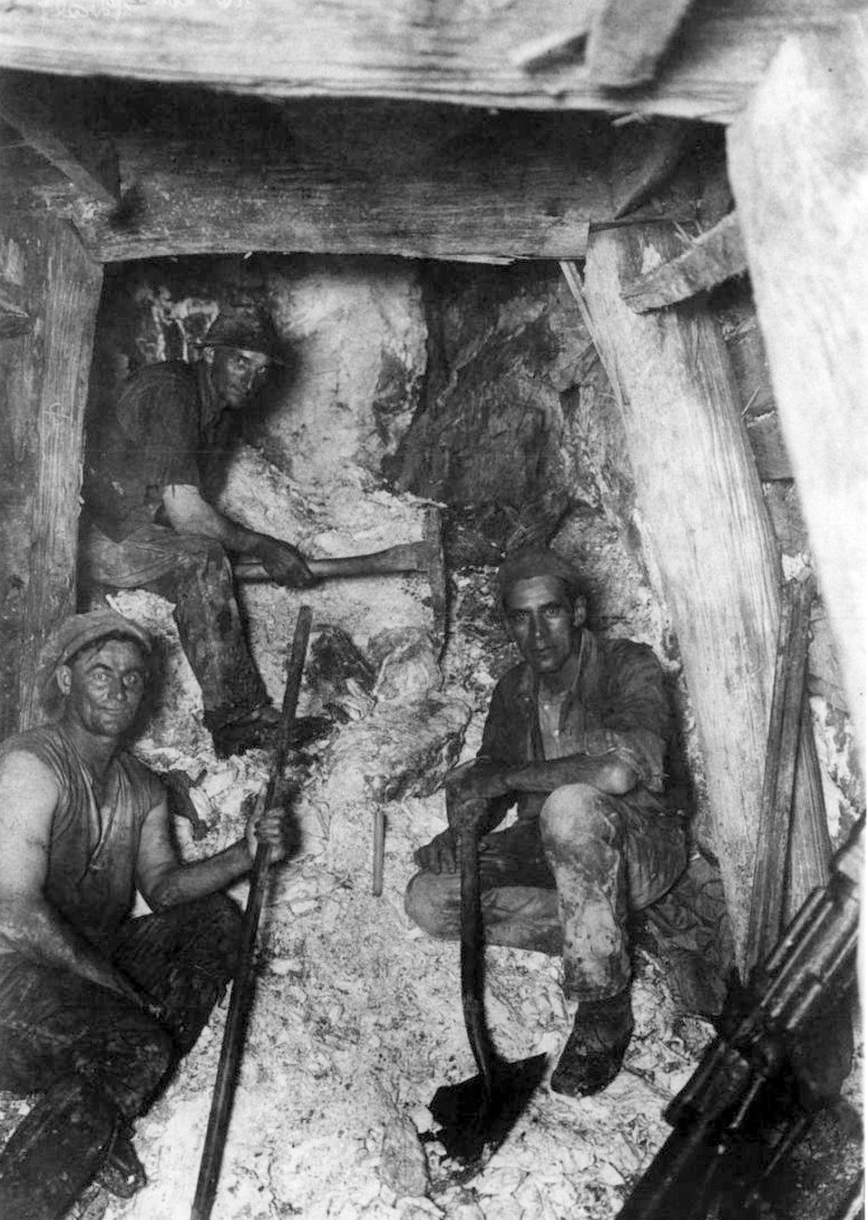 Goldminers (T. Beckworth, L. Williams and R. Hogg) underground at Waiuta in the 1930s taken by Joe Divis.