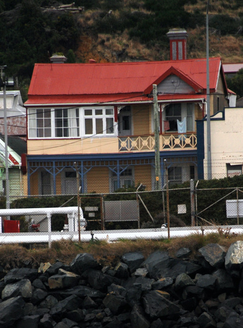 Colonial house with veranda and balcony on Marine Parade, Bluff, NZ.