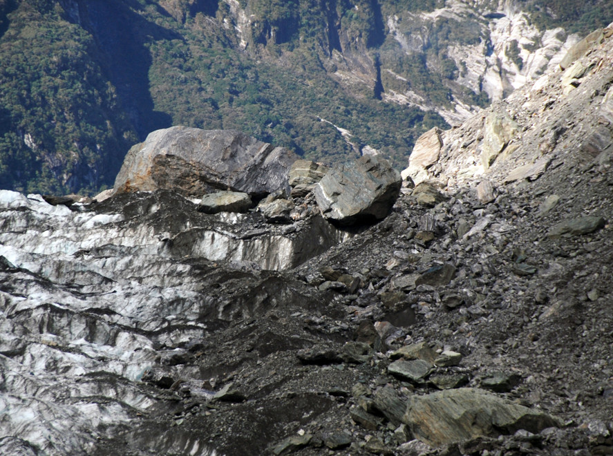 Rock debris, perched boulder and massive chunk of rock ion the right hand side of the Fox Glacier just below Victoria Flat.
