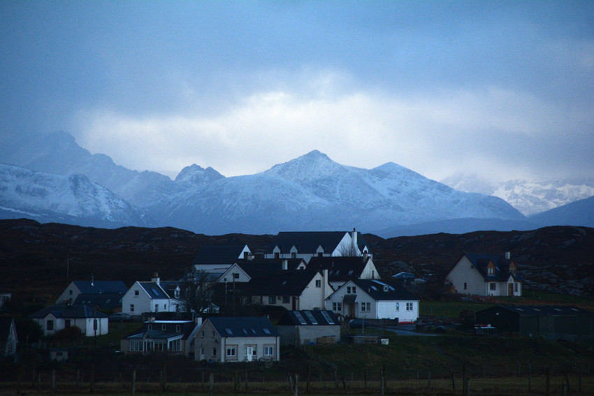 The clustered houses of Drumbuie and the mountains of Skye behind from the Plockton/Am Ploc and Kyle of Lochalsh road.