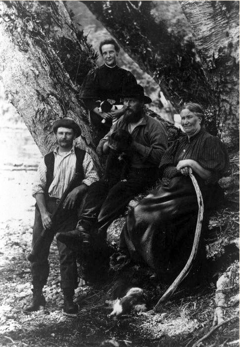 Donald and Elizabeth Sutherland with their maid and a guide, ca 1900 at Milford Sound (Click for link to Turnbull Library source).