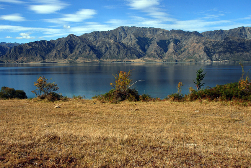 Lake Hawea, a deep glacial lake that feeds the mighty Clutha/Mata-Au river.