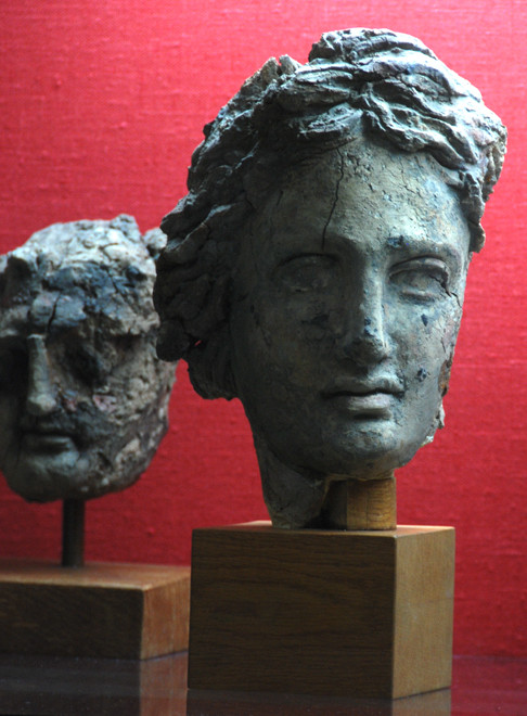 Clay head of a woman found on a funerary pyre from the Necropolis of Salamis, 4th Century BC, Cyprus Museum, Nicosia.