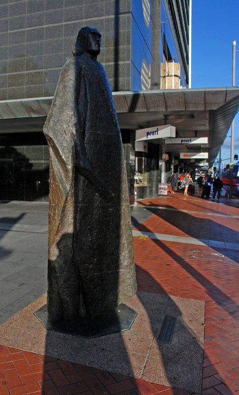 Bronze sculpture of 'A Maori Figure in a Kaitaka Cloak' (1964) by Molly Macalister at the confluence of Queen Street and the waterfront in Auckland's CBD. Click photo for Macalister biography.