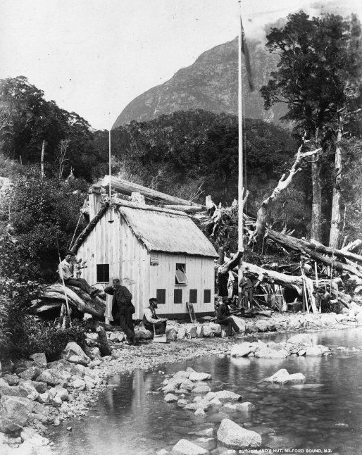 Five unidentified men outside Donald Sutherland's hut, the Esperance Chalet, Kennedy Station, Milford Sound, Southland. Taken by an unidentified photographer during the 1880s (Click for link)