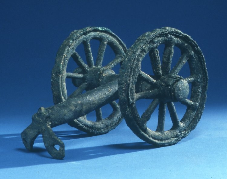Pair of wheels, axle and attachment column from a bronze stand from the Enkomi Foundry Hoard, 1200-1050 BC  height 19cm (c) British Museum