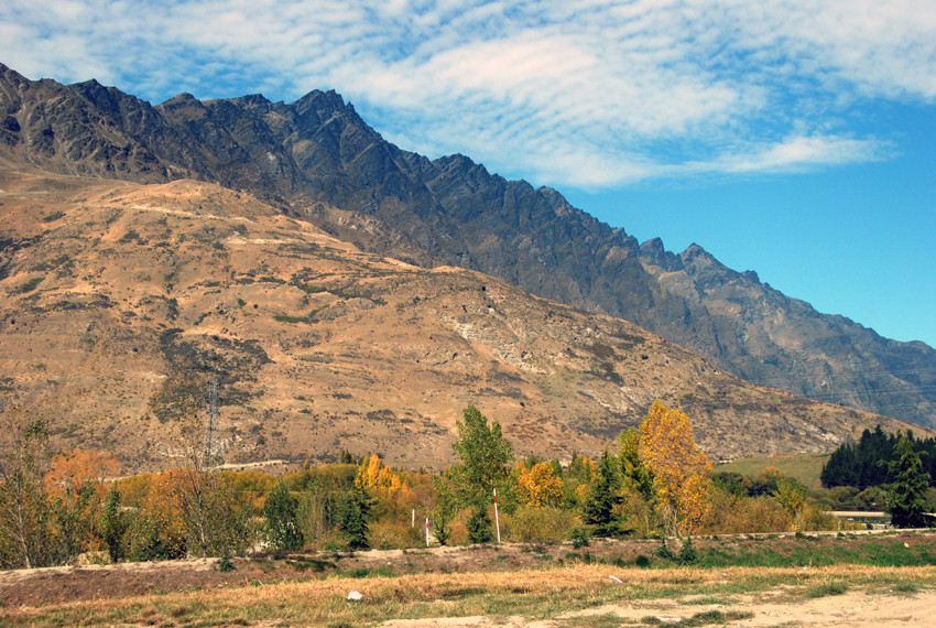 The northern end of The Remarkables, Otago with parched hills and early autumn colours.