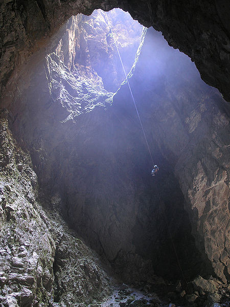 View of the entrance pit of Harwood Hole, New Zealand, taken from the bottom. It is 183 meters (about 600 feet) deep (Courtesy Dave Bunnell WikiCommons)