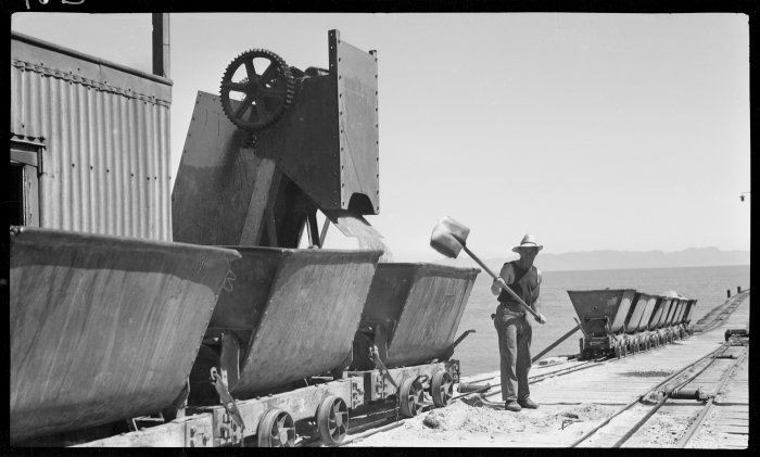 Picking up the spill at Golden Bay Cement Works (1939). The company ran from 1908 to 1988 supplying cement for the Manopuri Hydro scheme and the Clyde Dam (Click for credits).