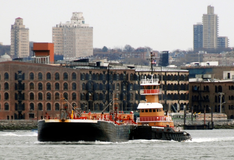 Tug, barge, warehouses and streetcars at Red Hook