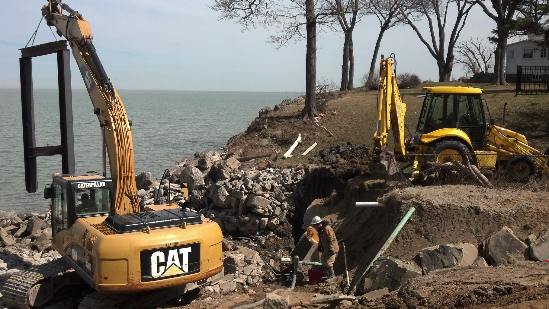 "Lakefront municipal storm sewer outfall construction using 60"" steel pipe construction with new H-pile footings"