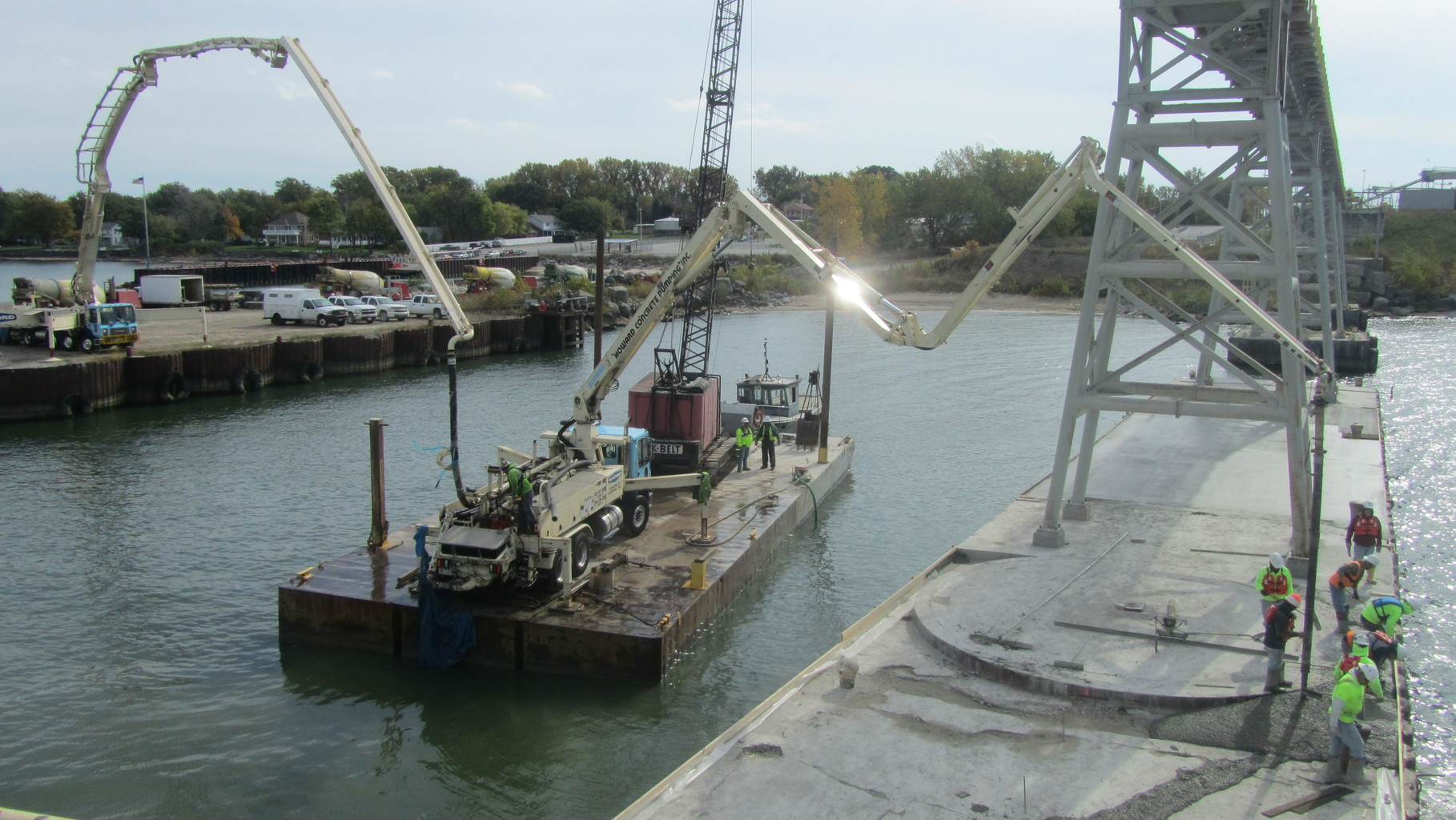 Amazing concrete deck repair by using two concrete pumps. One is the largest in Ohio, the other is floating on a barge!!