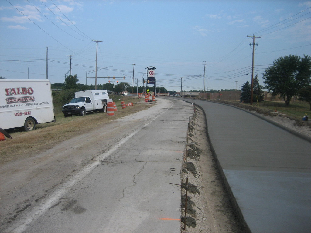 Single-lane municipal slipform concrete road construction
