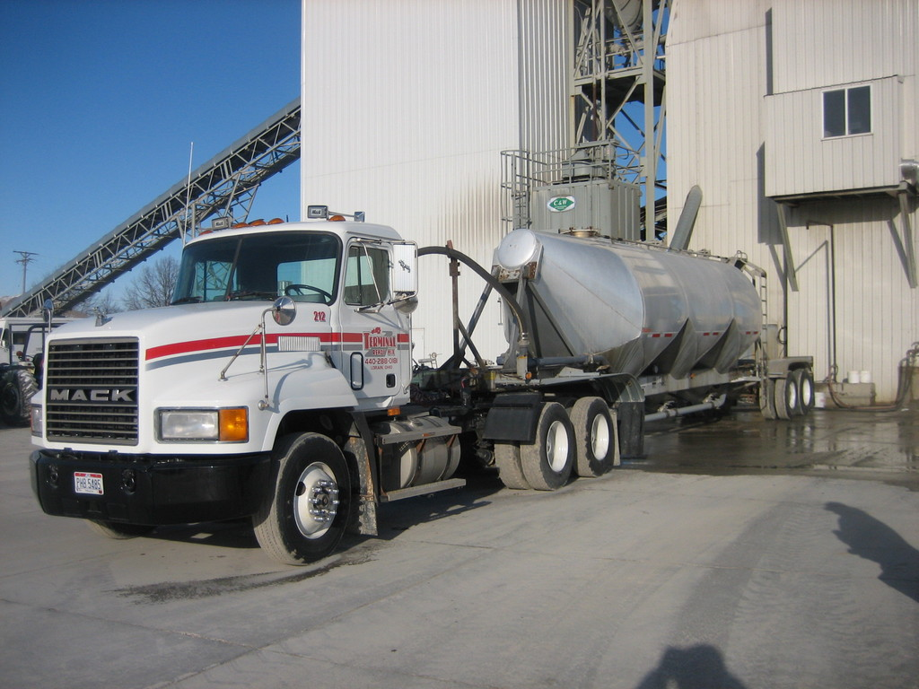 Cement can truck at the plant