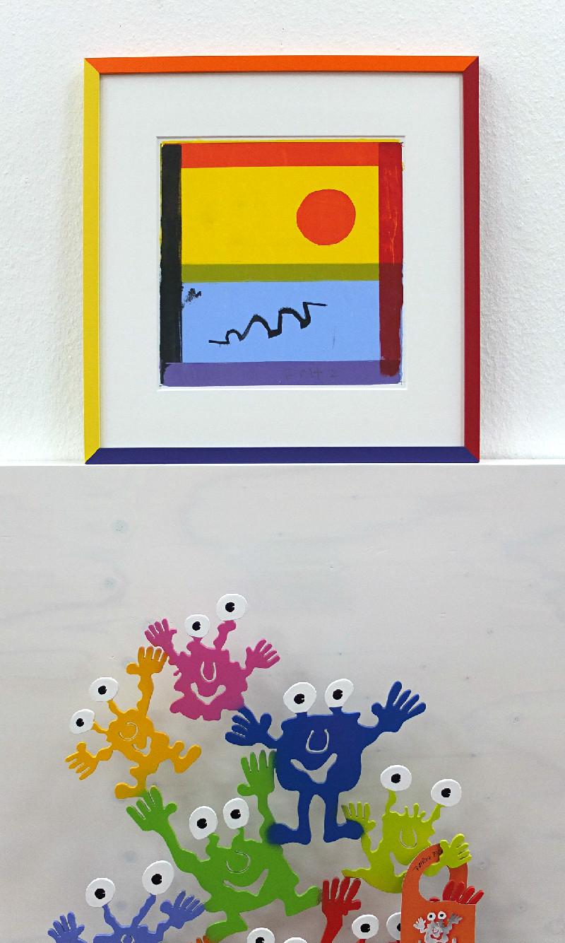 Vielfarbiger, bunter Bilderrahmen aus vier verschieden farbigen Rahmenleisten gefertigt