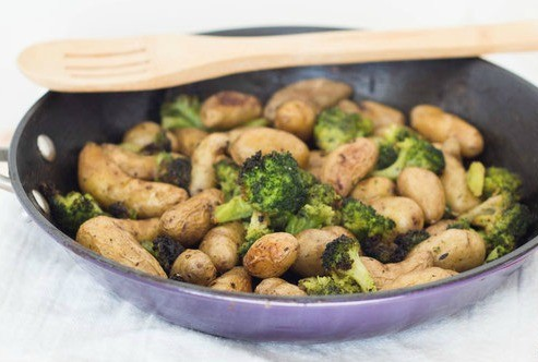 Easy Roasted Potatoes with broccoli make the perfect complement to any weeknight meal.  Just add your favorite cooked protein and you've got a complete, healthy meal! These easy roasted potatoes with broccoli make the perfect complement to any weeknight m