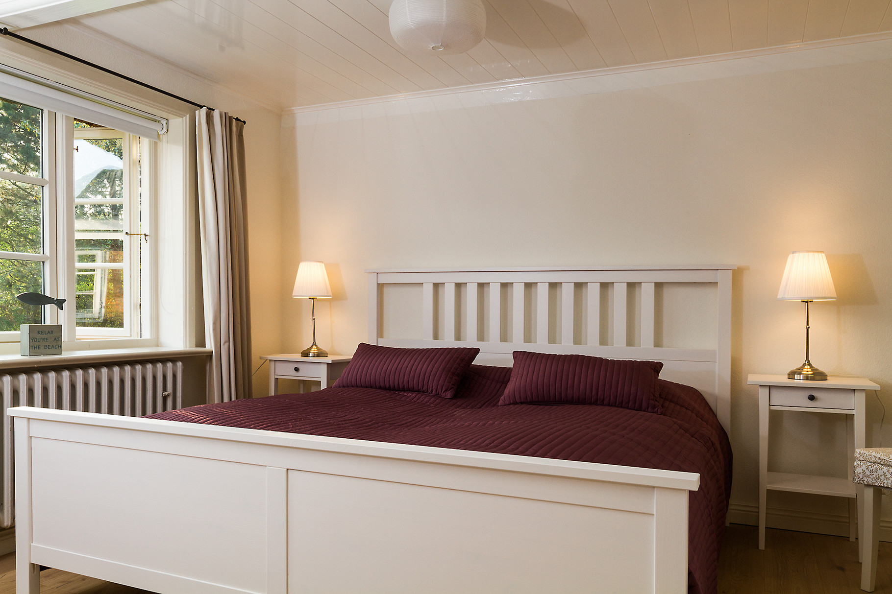Schlafbereich in einem Ferienhaus.