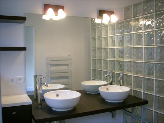 Réalisation d'une salle d'eau dans la chambre parentale.