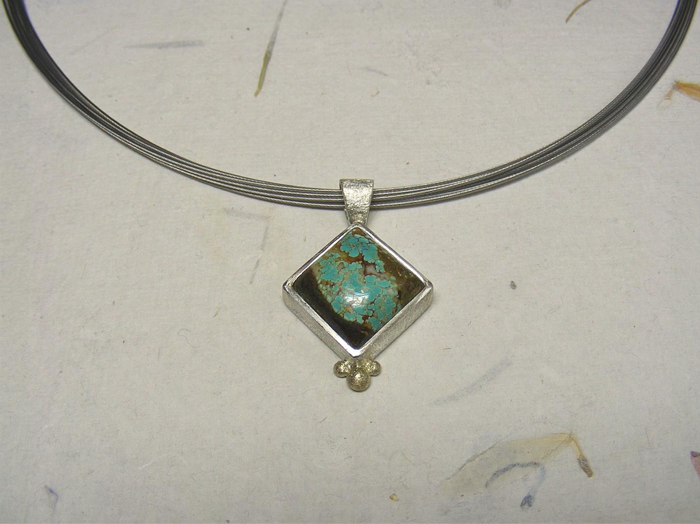 zilver, 14kt geelgoud en turquoise (Tibet) €130 (inclusief spang), te koop