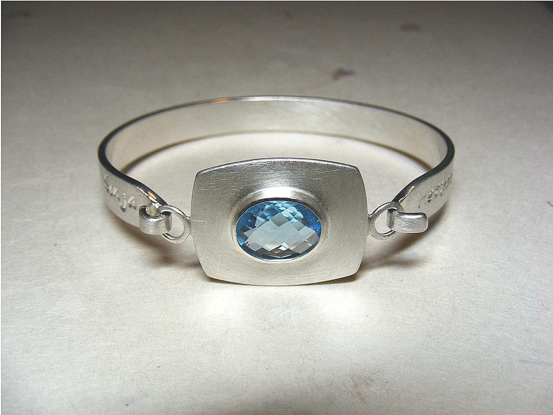 zilver en blauwe topaas