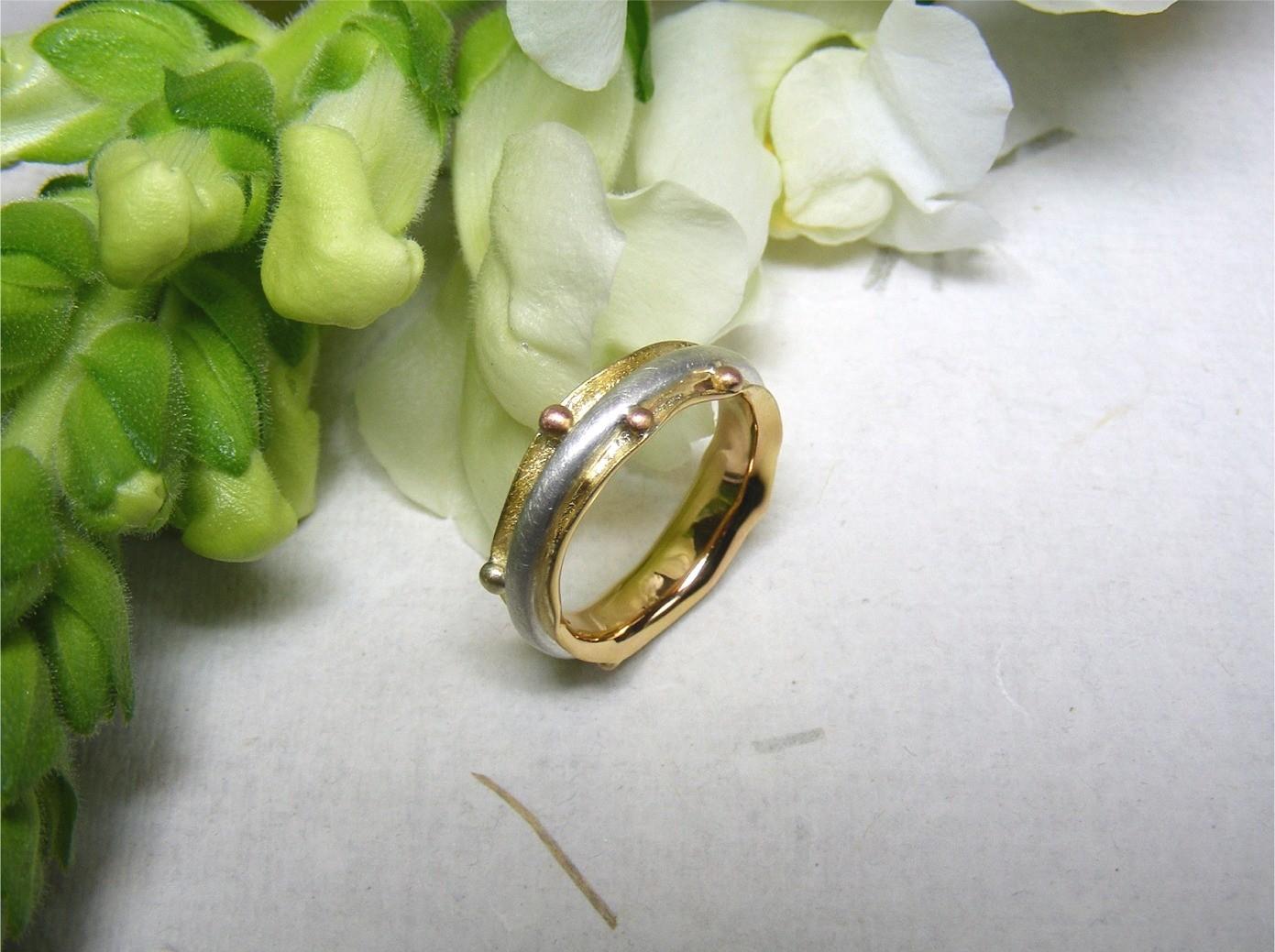 zilver, 14kt geel- en roodgoud €390