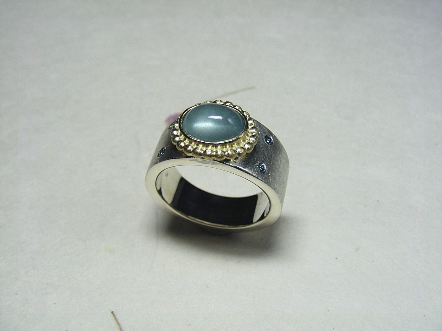 zilver, 14kt geelgoud, aquamarijn en lichtblauwe diamanten