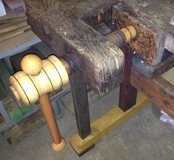 Shoulder vise on an old work bench.