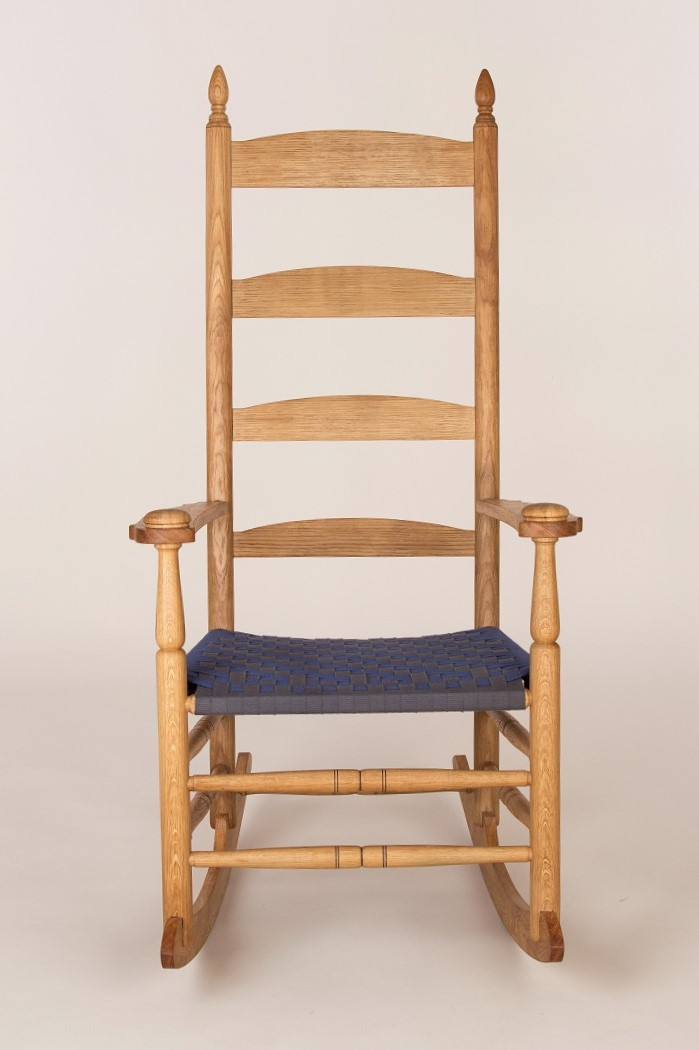 1830 Shaker rocking chair form turned oak with shaker tape herringbone pattern seat webbing.