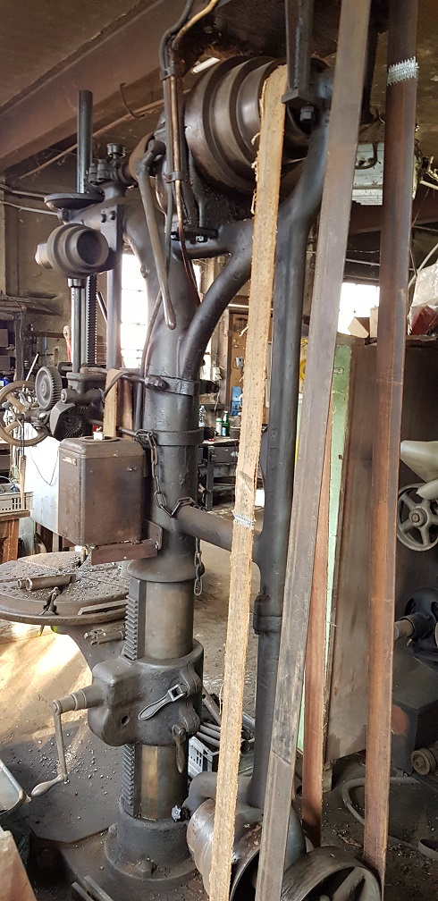 Belt driven drill press