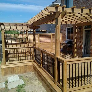 Soak up the sun and enjoy the shade with an expansive platform deck framed with an open-air pergola. Achieve a modern city vibe by accenting the rustic wood frame with trendy wrought iron rails.