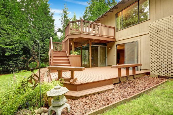 A deck built for entertaining, this multi-level design will quickly become a favorite gathering spot for after-work relaxing and weekend barbecues. Built-in bench seating, an elevated patio and a screened-in sun porch make this unique deck the showpiece o