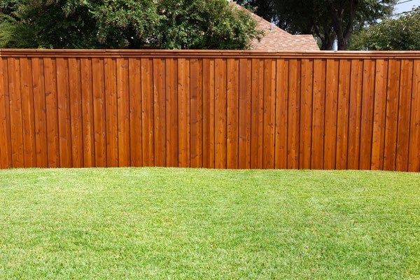Nothing enhances a striking green lawn like a classic privacy fence. Keep it simple with 6-foot-tall butted panels to create a secluded yard that serves as a retreat from the rest of the world.