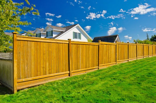 Easily build a beautiful fence along an uneven yard with pre-assembled panels that step up with the gently sloping grade.
