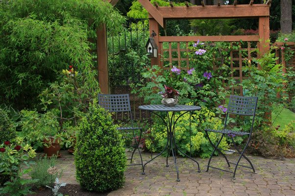 Carve out a stunningly lush garden from a small space with a pergola as the centerpiece. This quaint patio provides an oasis for everything from Sunday brunch to romantic date nights.